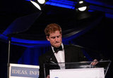 Prince Harry accepted the Distinguished Humanitarian Leadership Award on stage in Washington DC.