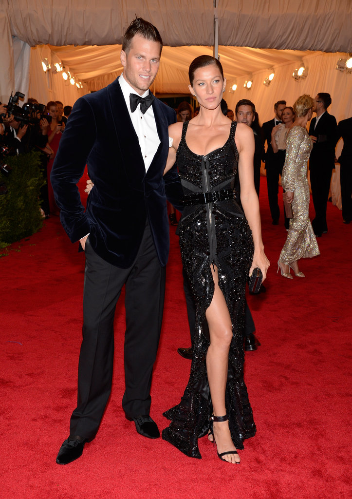 Gisele Bundchen struck a pose with Tom Brady on the red carpet of the Met Gala.