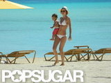 Miranda Kerr wore a white bikini while vacationing in Tahiti during May 2012 with her son Flynn Bloom.