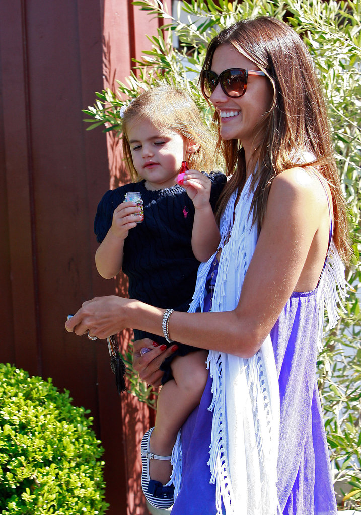 Alessandra Ambrosio flashed a smile while carrying daughter Anja Mazur in LA in August 2011.