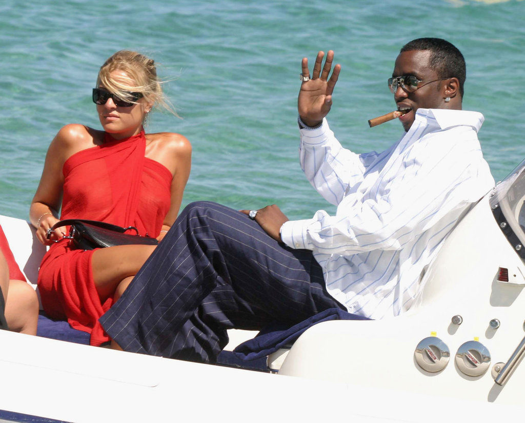 Diddy maxed and relaxed in a boat off the beach of Club 55 during July 2003 in St. Tropez.
