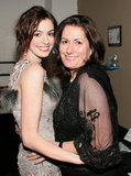 Anne Hathaway and her mother, Kate McCauly, shared an embrace backstage during an April 2005 charity event in NYC.