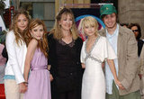 Mary-Kate and Ashley Olsen were honoured with a star on the Hollywood Walk of Fame in April 2004 with their sister Elizabeth, brother, Trent and mum, Jarnette, there to celebrate.