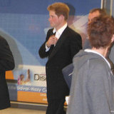 Prince Harry wore a suit at the airport.