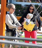 Pink and her baby daughter, Willow Hart, stopped to play on a swingset in LA in February 2012.