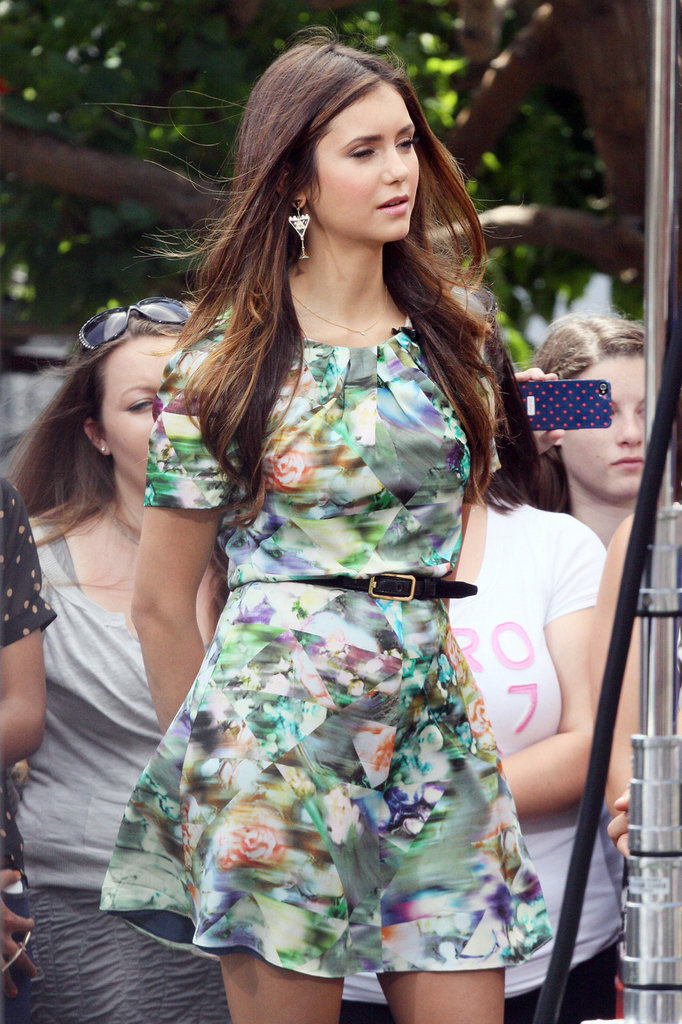 Nina Dobrev walked with her hands behind her back at The Grove.
