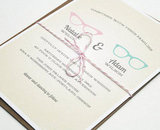 "If you fell in love with a fellow ""four eyes,"" the vintage geek-chic invitations ($3 each) are a fitting option."