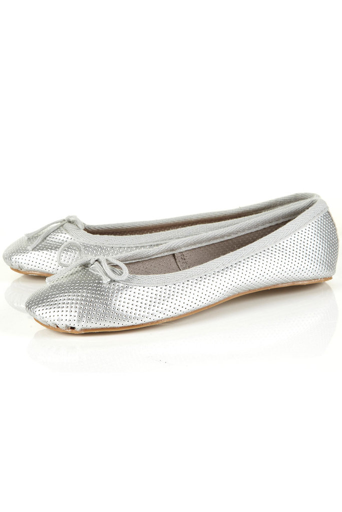 Keep comfy and cute with a pair of silver flats to dress up your office basics.  Topshop Vibrant Perforated Ballet Pumps ($36)