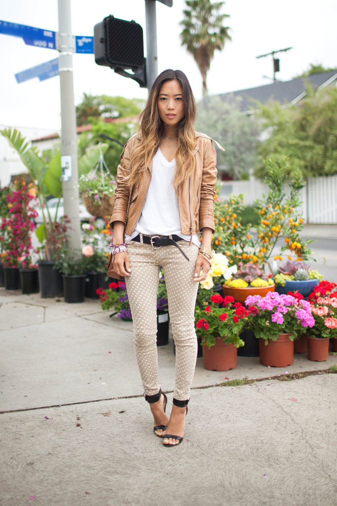 This style pro artfully paired white and tan polka dots with a buttery leather jacket that helped to temper the pattern and gave the whole look an underlying chic angle.  Photo courtesy of Song of Style