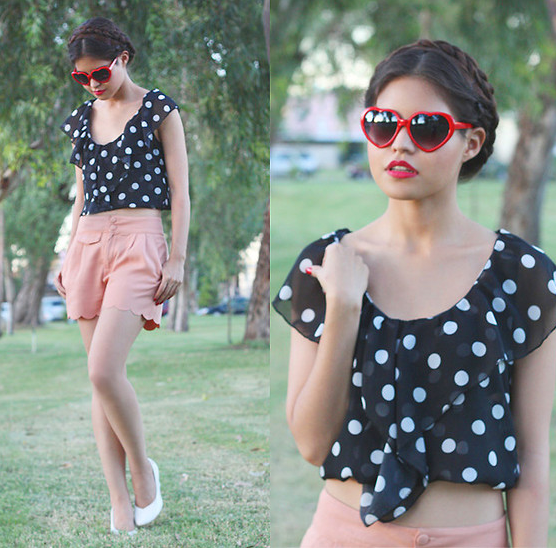 The most girlie of polka-dotted styles, thanks to a pair of sweetheart shades and a knotted blouse.  Photo courtesy of Lookbook.nu