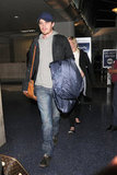 Garrett Hedlund led the way for Kirsten Dunst getting of a plane at LAX.