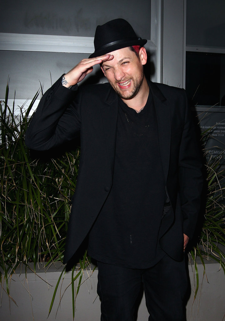 Joel Madden saluted photographers on his way to a party for The Voice Australia in Sydney.