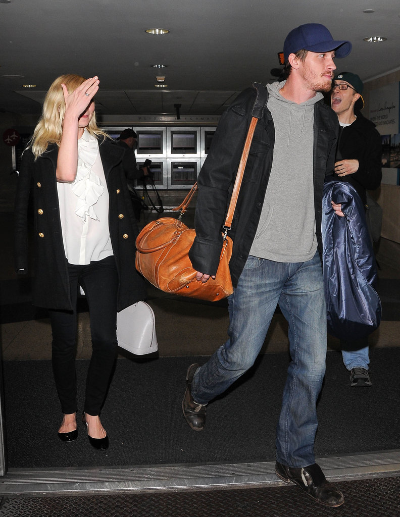 Kirsten Dunst and Garrett Hedlund carried their bags through LAX together.