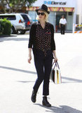 January Jones made us swoon with this cool daytime look — she wore a printed blouse with jeans and combat-style boots, then accessorized her ensemble with a black straw hat and bowler bag.