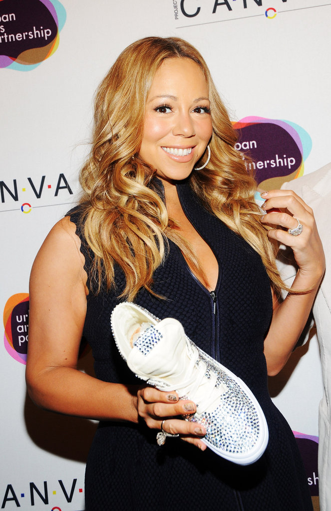 Mariah Carey took to a pair of sneakers at the Project Canvas Exhibition & Art Gala in NYC.