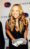 Mariah Carey laughed at the Project Canvas Exhibition & Art Gala in NYC.