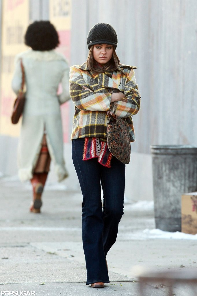 Mila Kunis wore a plaid coat on the set of Blood Ties in NYC.