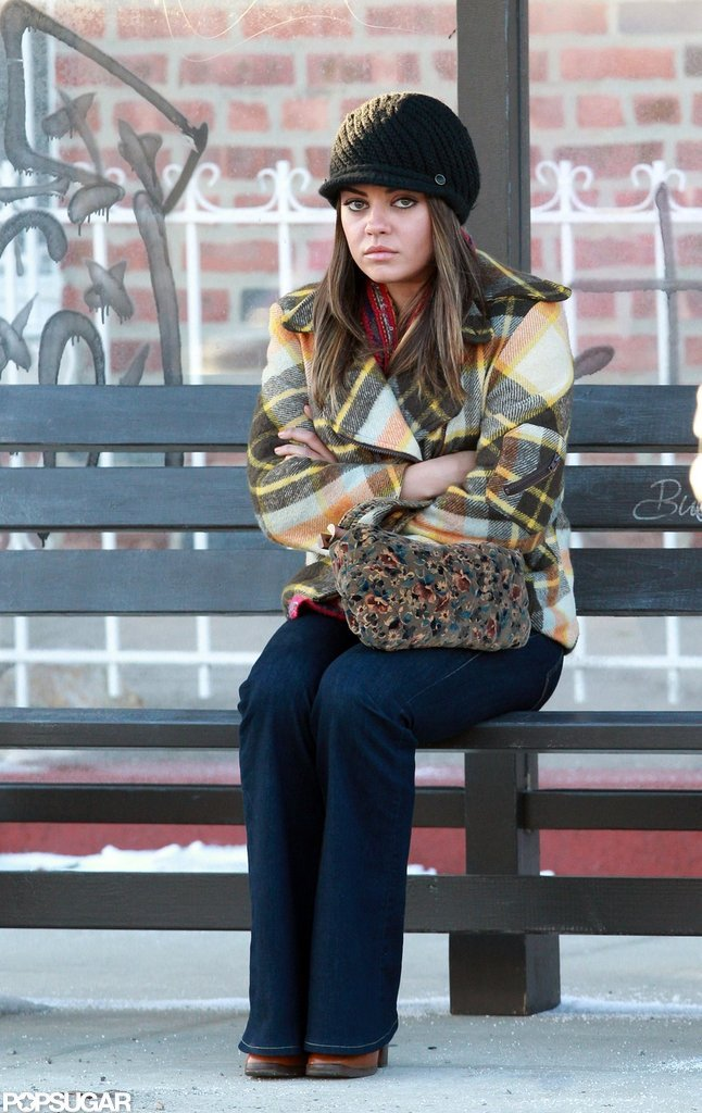 Mila Kunis sat on a bench on the set of Blood Ties in NYC.
