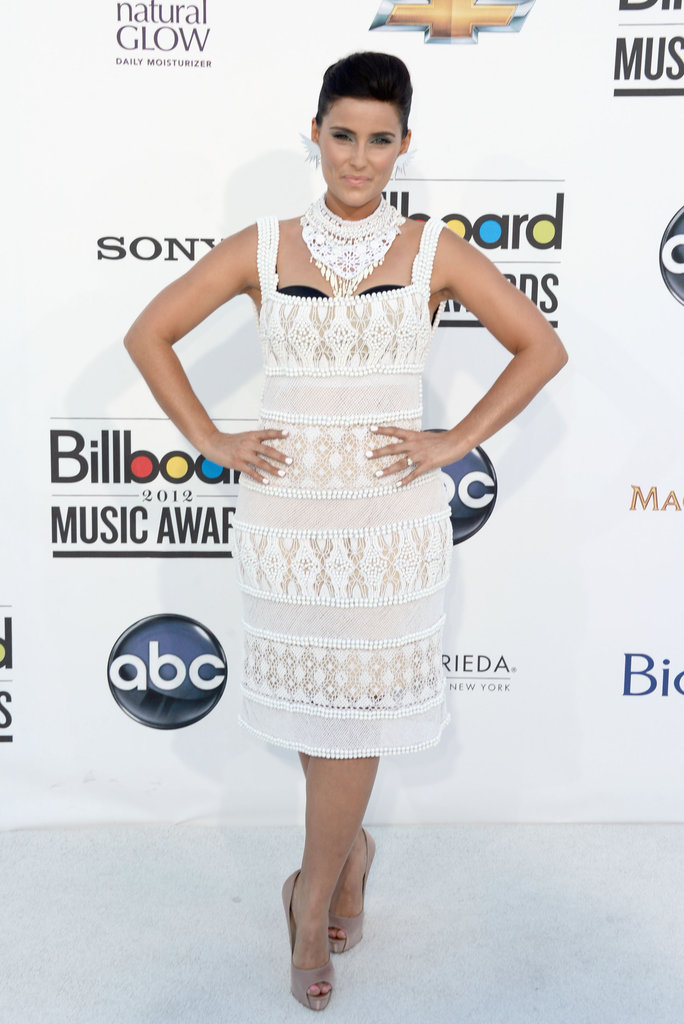 Nelly Furtado chose a sweet crochet-infused white frock by Alberta Ferretti.