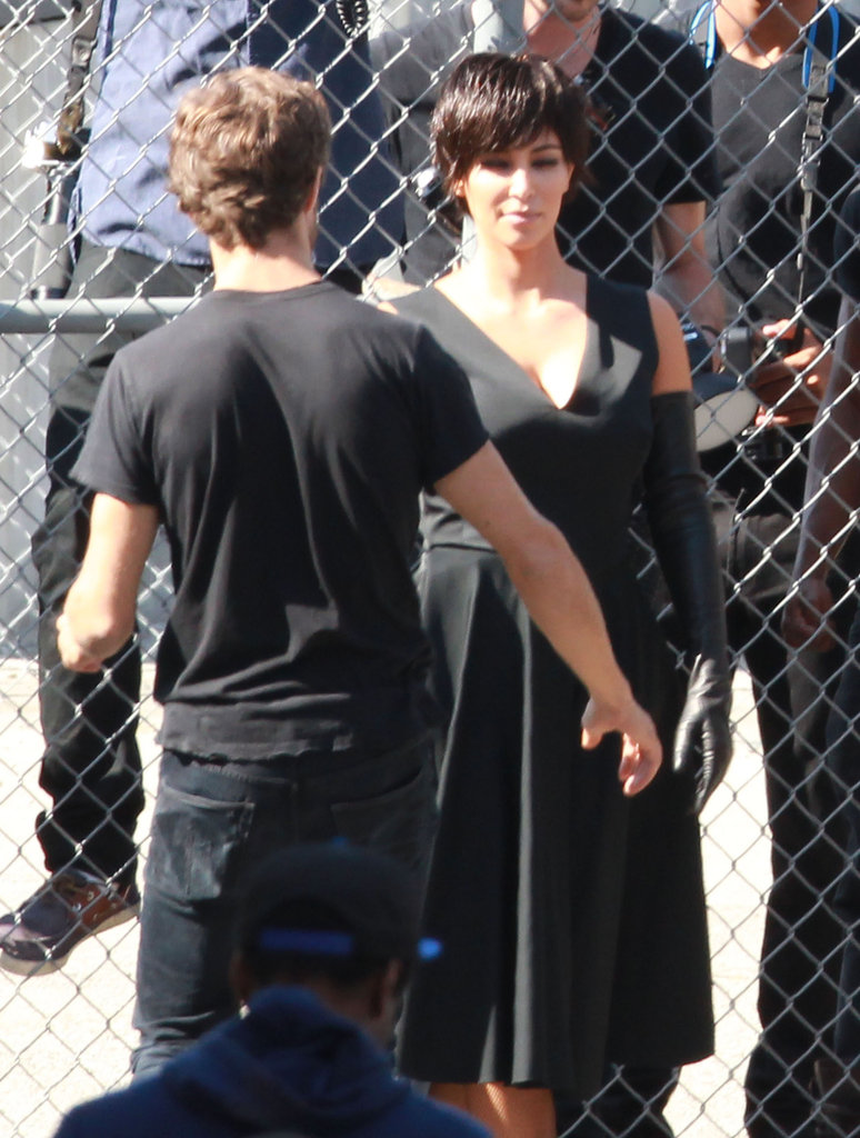 Kim Kardashian paired a black dress with dramatic black gloves.