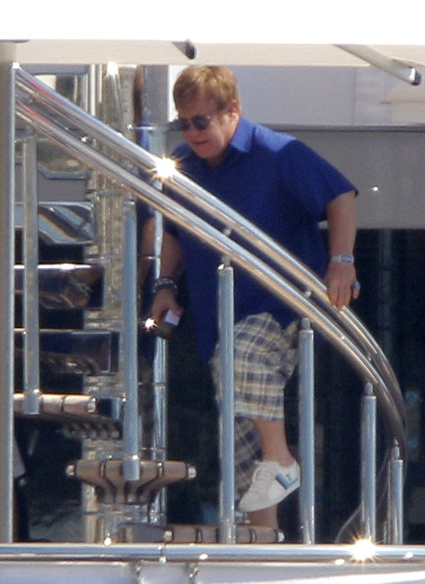 David Furnish boarded a mega-yacht in St. Jean Cap Ferrat in August 2011.