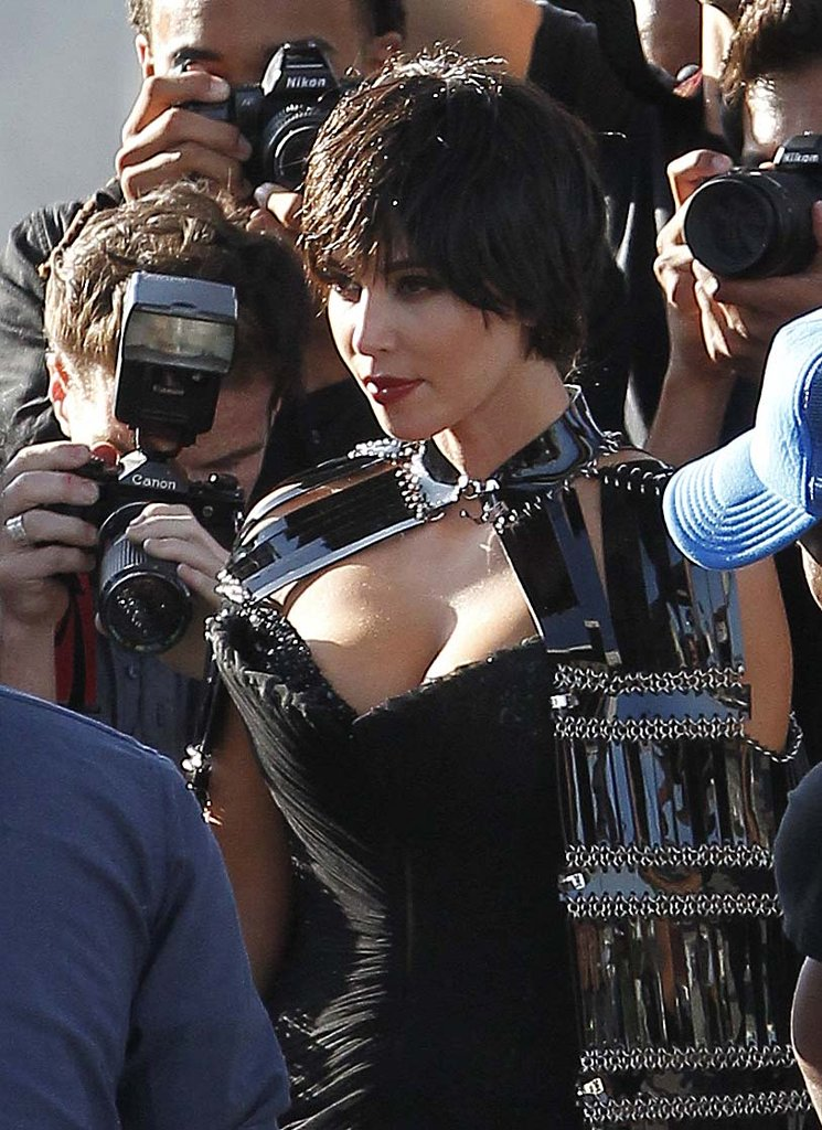 Kim Kardashian wore a short wig and dark lipstick for the photo shoot.