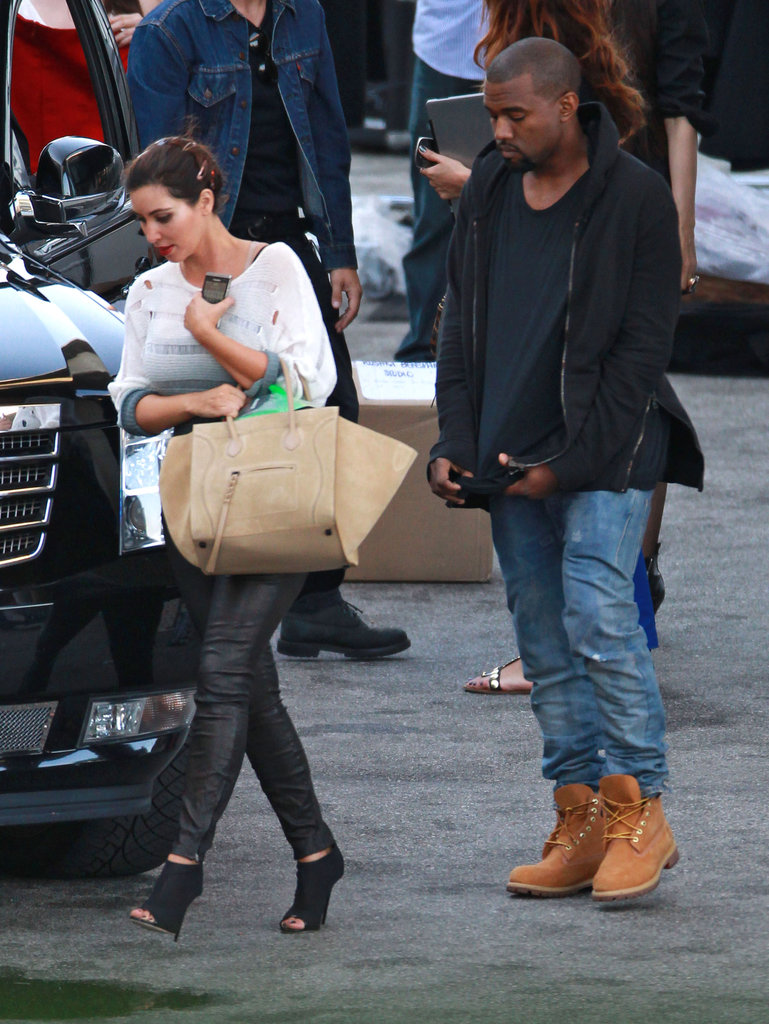 Kim Kardashian headed to the car with Kanye West after the photo shoot.
