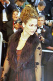 Jennifer Lopez wore a fur-collared dress to the 51st Cannes Film Festival in 1998.