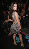 Megan Fox wore a low-backed dress to the February 2008 Gianni Versace Fall fashion show.