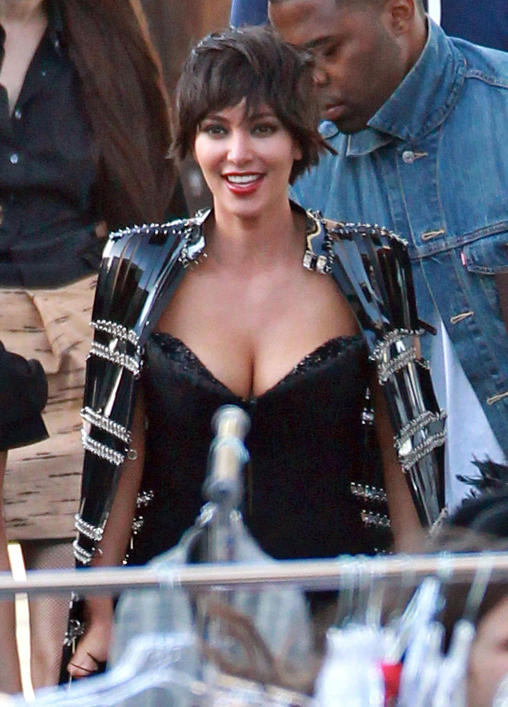 Kim Kardashian was all smiles on the set of Vogue Italia's photo shoot.