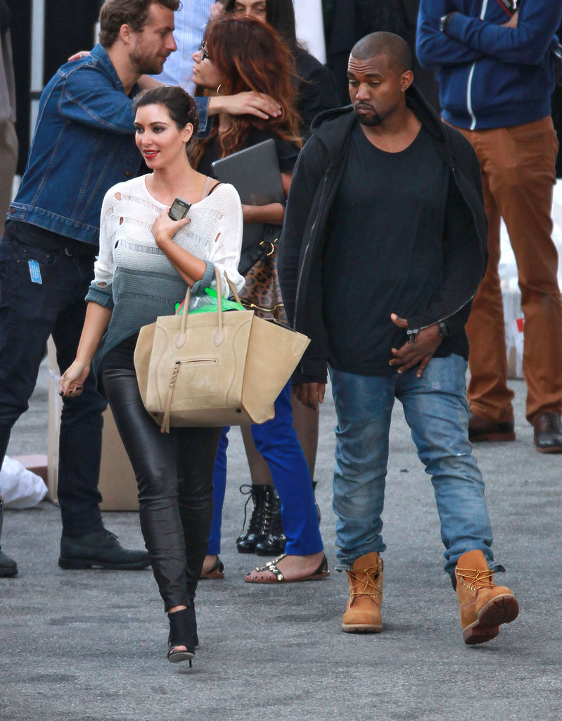 Kim Kardashian carried an oversized bag and walked with Kanye West in LA.