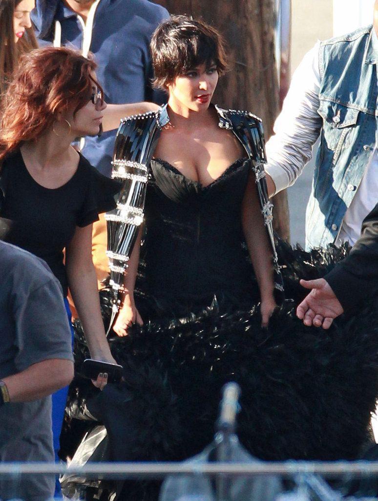 Kim Kardashian wore a low-cut gown for the photo shoot.