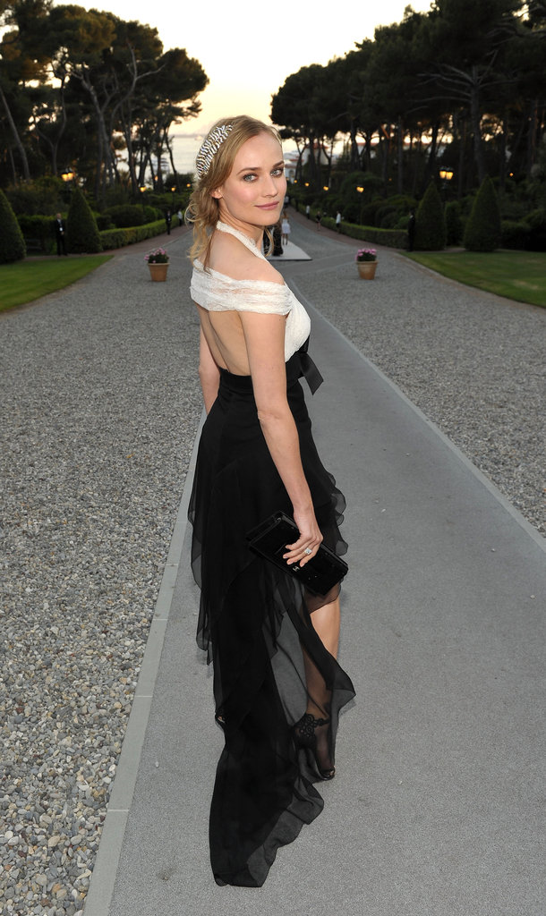 We love the daring backless detail and long asymmetrical train to Diane's Chanel dress.