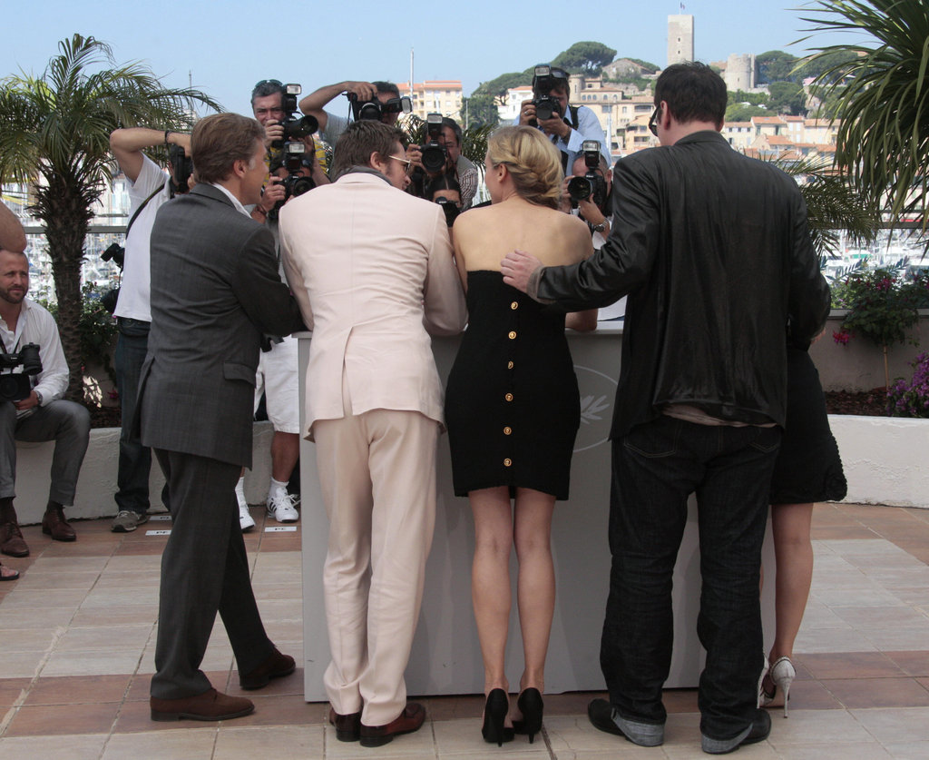 How cool is the gold-buttoned back of Diane's strapless LBD?