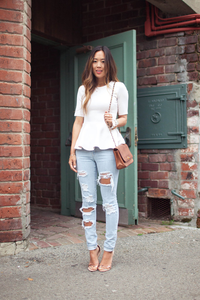 With distressed denim on bottom but polished peplum and pumps completing the look, this ensemble is the perfect cool-girl look for a night out with the girls. Photo courtesy of Song of Style