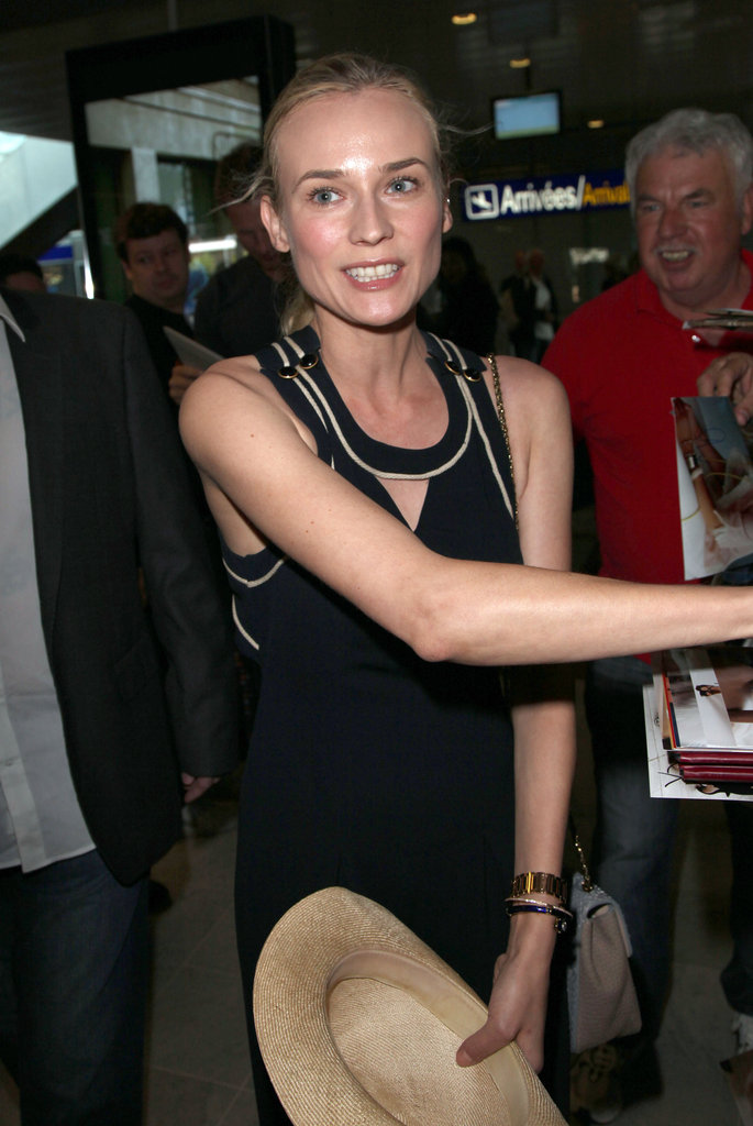Diane Kruger signed autographs on her way out of the Nice airport.