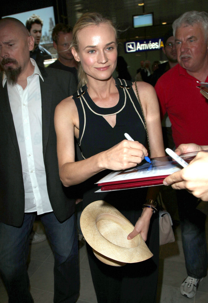 Diane Kruger smiled and signed pictures for fans after landing in the Nice airport.