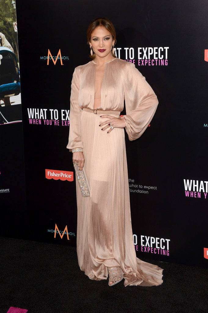 Jennifer Lopez dazzled in a silky Maria Lucia Hohan gown, which she complemented with a glimmering clutch, coordinating Sergio Rossi heels, and Jacqueline Nerguizian jewels.