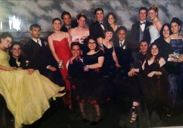 GeekSugar assistant editor Kelly Schwarze is spotted in the back row of this group shot wearing an elegant navy dress.