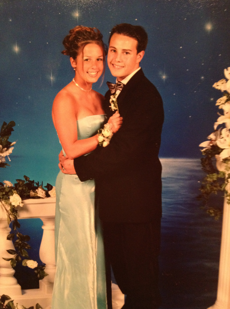 Sugar's audience development associate, Stacy Faber, in a blue backless dress and fancy updo at her 2001 junior prom.