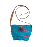 While the actual bag is off-duty chic, we think the turquoise-pink color combo dresses up this straw bag. Wear it with your bikini or with your Summer errands ensemble, it's super versatile. Bamboula Ltd. Little Market Bag ($58)