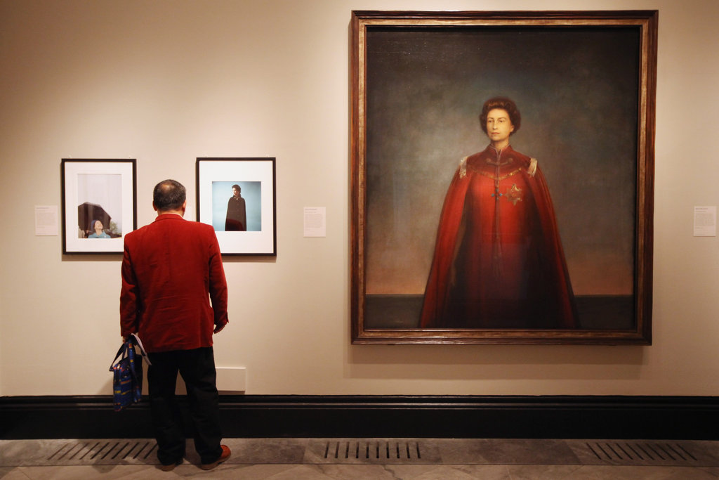 "A man viewed images of the queen including one by artist Pietro Annigoni titled ""Queen Elizabeth II."""