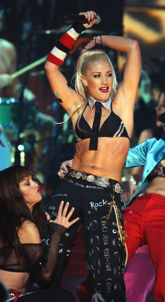 Gwen Stefani showed off her stomach during a December 2001 performance.