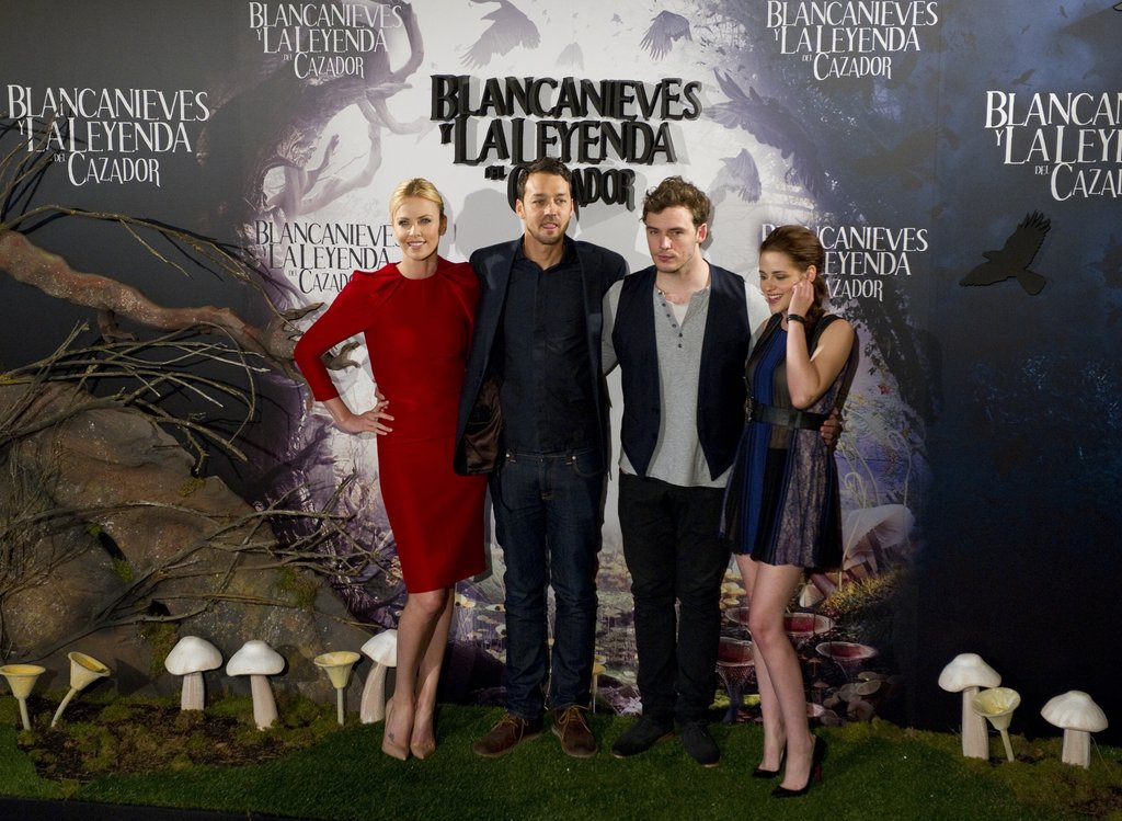 Charlize Theron, Rupert Sanders, Sam Claflin, and Kristen Stewart were arm in arm at the Snow White and the Huntsman photocall in Madrid.