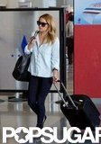 Lauren Conrad wheeled her luggage.