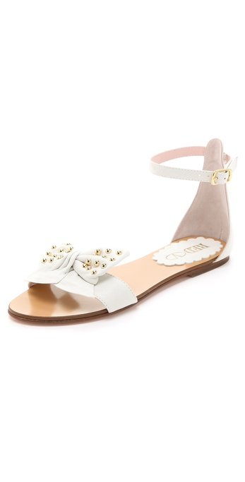 These will appeal both to the girlie-girl and your inner cool-girl thanks to studs, bows, and a flat go-anywhere silhouette.  Red Valentino Studded Bow Flat Sandals ($295)