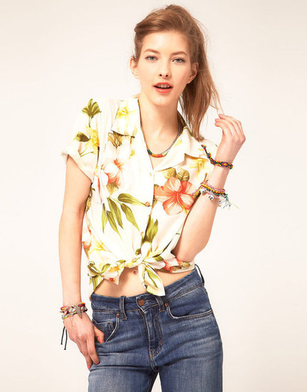 For a playful take on a Hawaiian print, try a cropped tie-front blouse. The Summer-perfect shape will give the bold floral style an added punch of cool. Paradise Found Hibiscus Summer Hawaiian Shirt ($148)