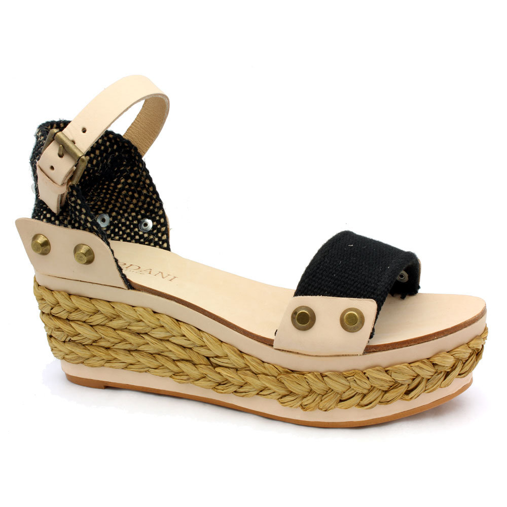 This totally unique take on espadrilles boasts a clever play on texture and studding.  Cordani Jameson Black Linen and Leather Platform Sandals ($295)