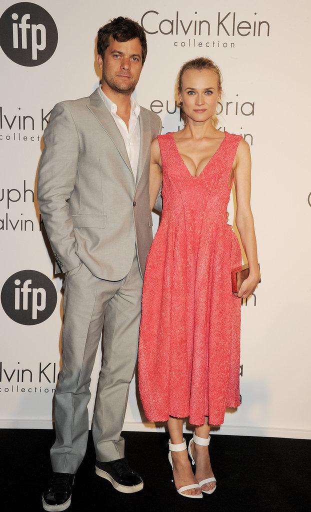 What a gorgeous couple! Diane Kruger arrived at the Calvin Klein Women in Film party with boyfriend Joshua Jackson and looked perfect in a tea-length coral Calvin Klein creation and white Givenchy sandals.