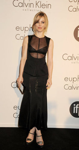 Actress Melissa George wore a black column-style Calvin Klein dress, but the slick details (sheer insets and a peplum silhouette) made it much more interesting.